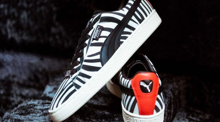 8d11c9327e1 The Suede base material is debossed with zebra print and silver leather  Formstrip. The leather heel tab shines in radiant red coming with an  off-white ...